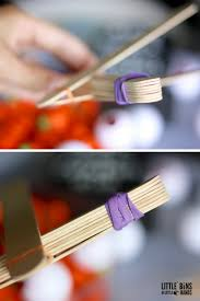 halloween popsicle stick catapult stem activity for kids