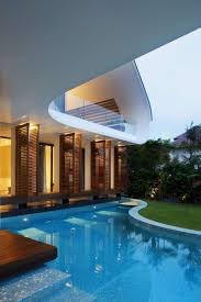 outdoor pool of magnificent and ultra modern house half surrounded