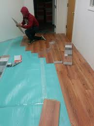 How To Lay Laminate Flooring In Multiple Rooms How To Lay Laminate Flooring Steps With Pictures Wikihow Cut Idolza