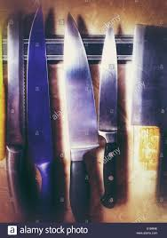 magnetic strips for kitchen knives row of knives hanging on a magnetic strip in a kitchen stock photo