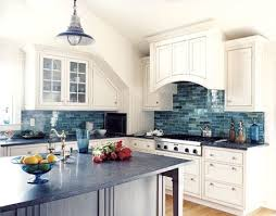 blue tile kitchen backsplash a dip in the blue gray island white cabinets and coloured glass