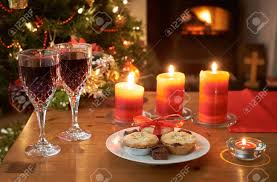 a christmas tree scene at night with glasses of wine mince pies