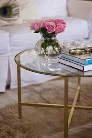 how to decorate a round coffee table 12 round coffee tables we love coffee rounding and living rooms