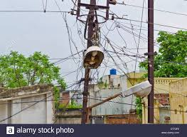 electric pole with messy wires in an indian street stock photo