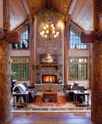interior vertical great room toward fireplace and windows