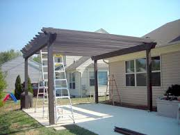 Outdoor Fabric For Pergola Roof by Favorable Small Wooden Pergola Roof Over Outdoor Stone Kitchen