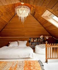 Different Lighting Fixtures by Wooden Attic Bedroom With Chandelier And Skylight Different
