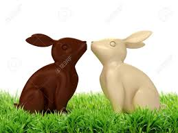 chocolate rabbits 3d illustration of chocolate rabbits in green grass stock photo