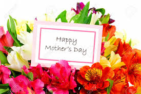 flowers for s day happy mothers day tag among a bouquet of flowers stock photo