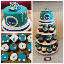 brown and turquoise giraffe baby shower cake with zebra print and
