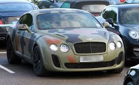 bentley dark green mario balotelli shows off his camouflage bentley continental gt