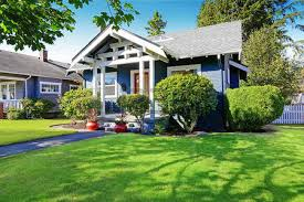 simple house exterior with tile roof front porch with curb appeal