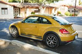 yellow baja bug review vw u0027s new beetle dune is a worthwhile distraction