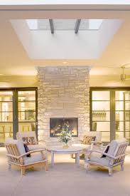 Sided Outdoor Fireplace - indoor outdoor fireplace patio contemporary with armchairs
