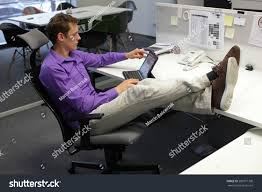 Legs On Desk Young Businessman Caucasian His Office Working Stock Photo