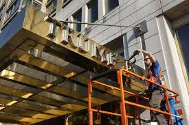 workers pry gold u0027trump place u0027 name off apartment buildings