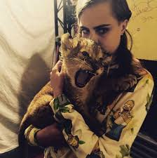 cara delevingne u0027s lion tattoo see the model bring her famous ink