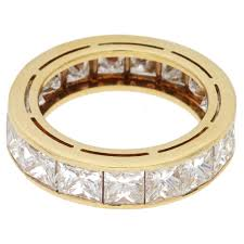 gold eternity ring a princess cut diamond eternity ring in yellow gold