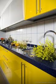 image result for yellow kitchen cabinets cascade kitchen
