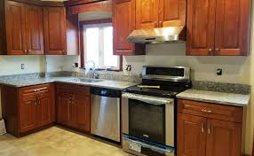 maple kitchen cabinets with white granite countertops countertops and kitchen cabinets in boston and marshfield