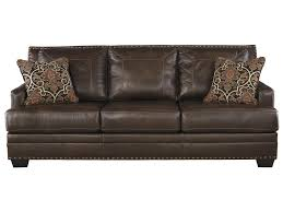 signature design by ashley corvan leather match queen sofa sleeper