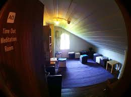 small and narrow attic meditation room design with white wood