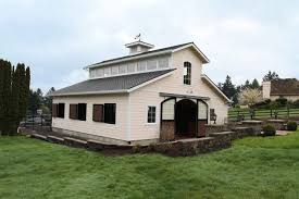 raised center aisle stable by equine facility design stables
