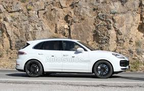 porsche 2017 white 2018 porsche cayenne smiles for the camera wearing all white