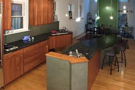 light wood kitchen cabinets with black countertops contemporary kitchen with wood cabinets black countertops