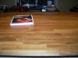 wood countertops good idea i have butcher block on my island and will have black laminate on the perimeter counters i really like it and i love the look of wood counter tops