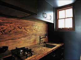 amazing kitchen with pendant lights also slate counter backsplash