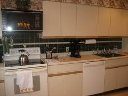 updating old kitchen cabinet ideas how to update white melamine kitchen cabinets memsaheb net
