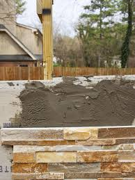 How To Install A Concrete Patio How To Build An Outdoor Stacked Stone Fireplace Hgtv