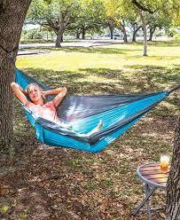 outdoor furniture hammock swing chairs half umbrellas lakeside