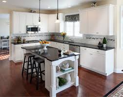 kitchen brown wooden flooring brown kitchen islands black