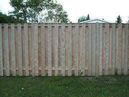 exterior cubical box planter to decorate backyard wooden fence