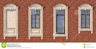 framing of windows in classic style on the brick wall of red color