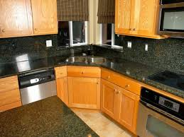 ivory oak kitchen cabinet with black granite counter tops and back