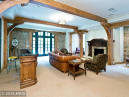 traditional family room with exposed beam u0026 flush light in