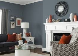 gray living room furniture stone fireplace arched door white table