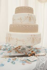a spectacular 6 tiered wedding cake decorated with macaroons and
