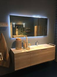 backlit mirrors the focal points of the modern bathrooms