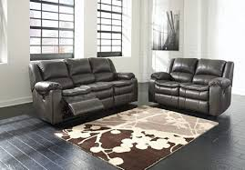 blue leather reclining sofa together with gray sleeper plus repair