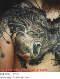 evil demon tattoo design on chest photos pictures and sketches