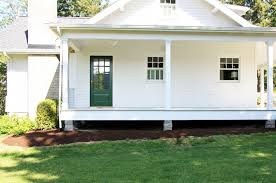 old farmhouse plans with wrap around porches a country farmhouse the evolution of the exterior front door