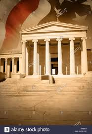 Flag Law A City Courthouse Law Building With Pillar Columns And Stairs An