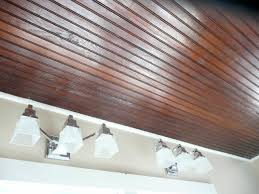 picturesque brown varnished like wood beadboard ceiling over wall