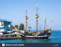 the replica of a pirate ship docked in george town grand cayman