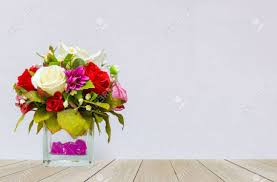 beautiful multi color of roses in glass flowerpot at the corner
