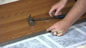 How To Fix A Piece Of Laminate Flooring Transitioning From Laminate Flooring To Linoleum Working On